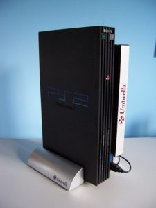 Sony Playstation  with Capcom Umbrella Stand and light